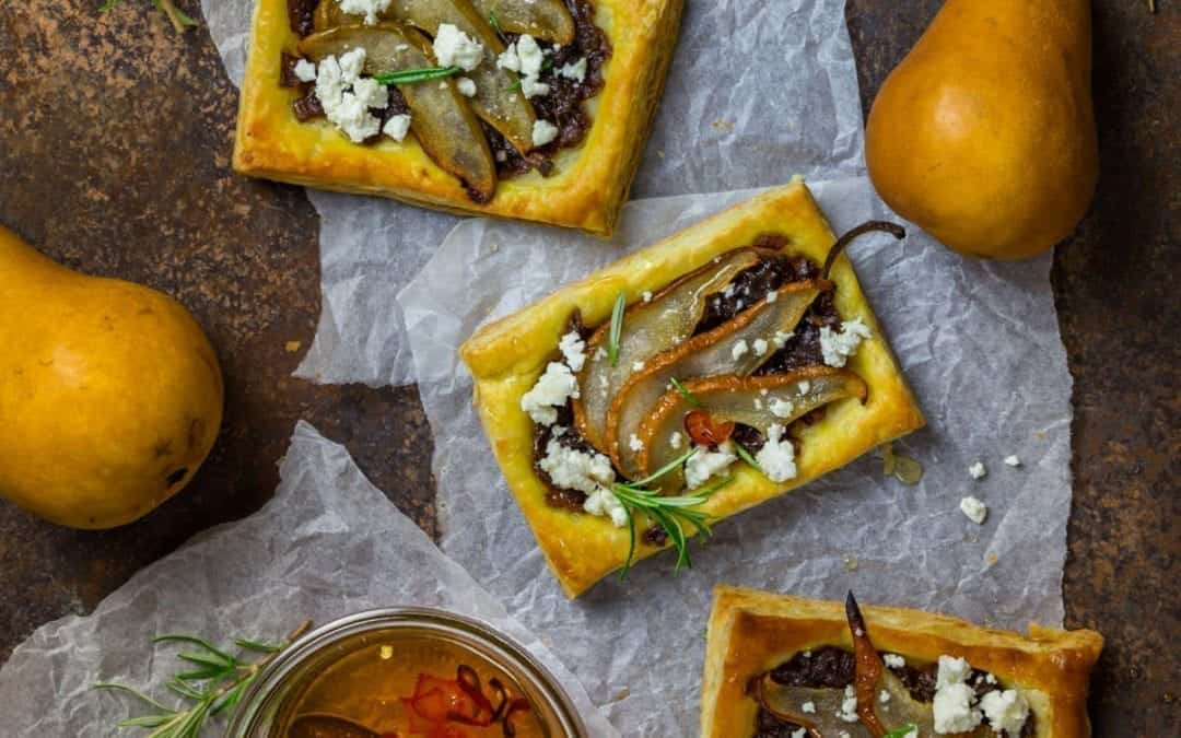 Caramelized Red Onion and Pear Tarts with Goat Cheese and Spicy Honey Drizzle